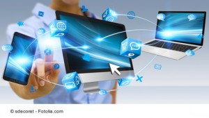 Businesswoman connecting tech devices computer phone and tablet